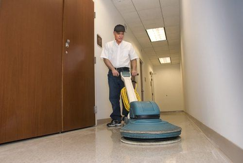 Floor cleaning equipment in use with advanced techniques by a SanMar technician. Office cleaning services NYC